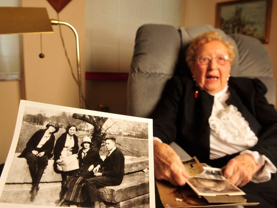 Louise Baird Short shows a photo of the day she met her husband. Roy H. Short died in the 1990s at the age of 92.