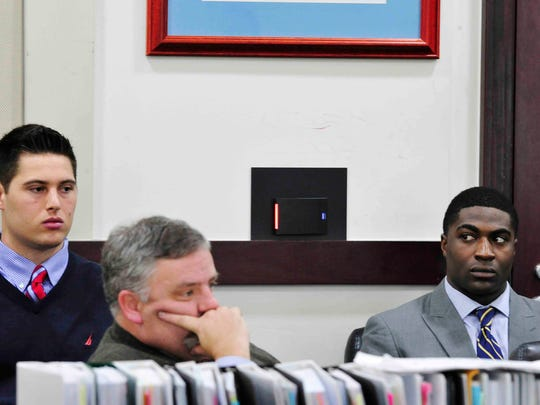 Defendant Brandon Vandenburg, left, and Cory Batey, right, listen with attorney Fletcher Long during testimony Thursday in the Vanderbilt rape case at the Justice A. A. Birch Building in Nashville.