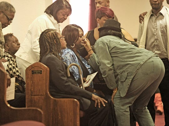 Amelia Griswood, aunt of 15-year-old DaVontae Ziegler, gets a tear wiped away by a family member during the funeral at Greater Revelations Missionary Baptist Church on Saturday.
