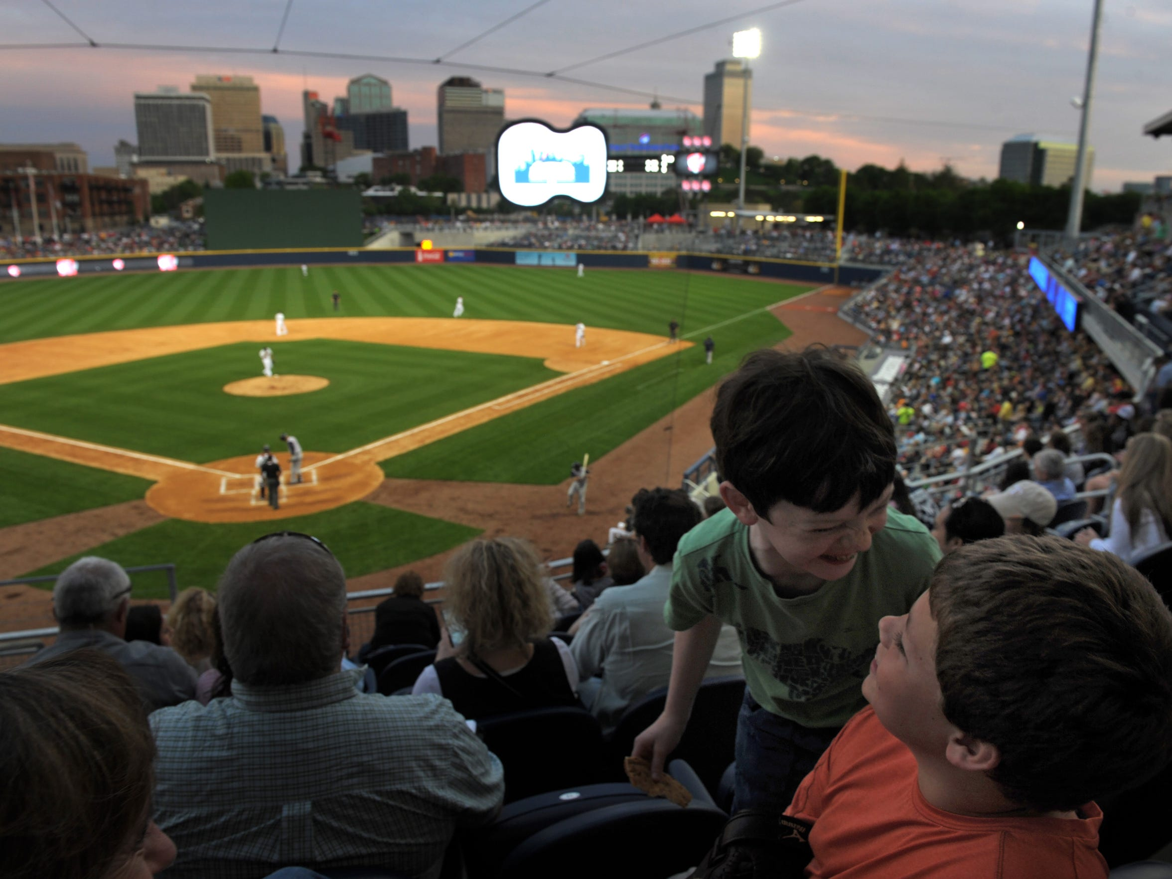 Friends Frank Hancock, 10, and Alex Humphrey, 11, have gone to all the past Sounds game but were celebrating opening day First Tennessee Park on Friday April 17, 2015, in Nashville in Tenn.