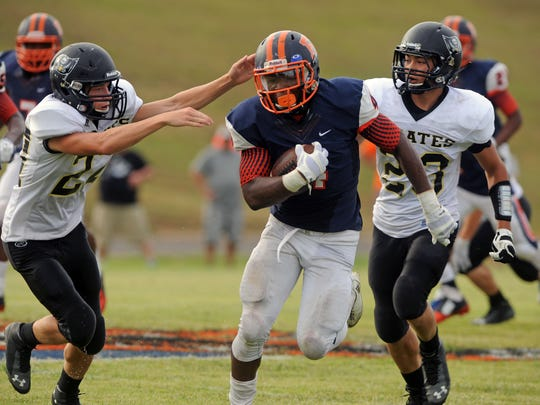 Escambia High senior Terik Miller runs down the field in the season opener. Miller's parents have filed a lawsuit on his behalf.
