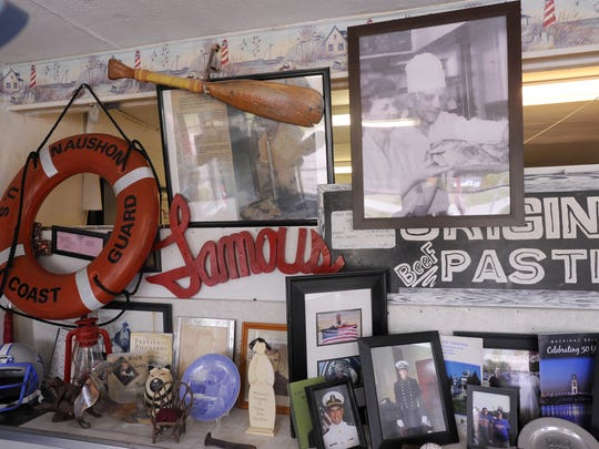 Mementos on the wall at Bill and Laurie Walker's Lehto's Pasties in St. Ignace.
