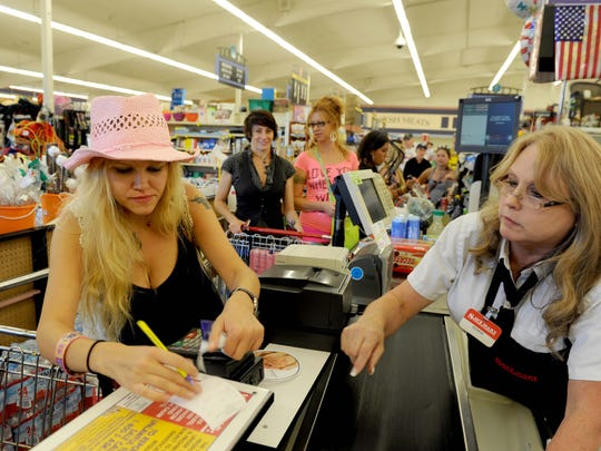 Emi from Turkey checks out with help of Donna Clark at SaveMart on Keystone, ahead of the 2012 Burning Man event.