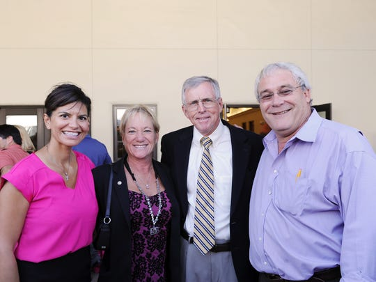 "From left, Claudia Pizarro-Villalobos, Margaret D'Arrigo Martin, John Phillips and Dennis Donohue at the ""Pink Party & Press Conference"" held at D'Arrigo Brothers headquarters in Salinas. The event commemorated a 15-year combined effort in the fight against breast cancer."