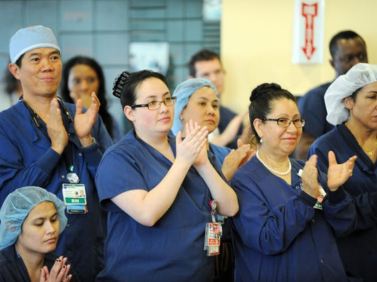 Surgical services staff applauds at a ceremony on Monday marking Natividad Medical Center's designation as a Level II Trauma Center for Monterey County.