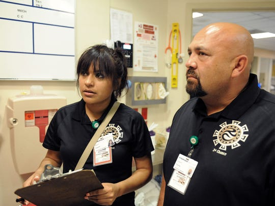 CHOICE team members Alma Cervantes and Juvenal Farias in the Natividad Trauma Center on Monday in Salinas.