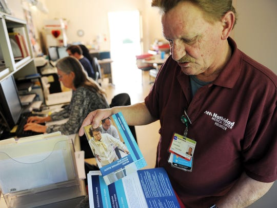Among his many duties as a volunteer, Steve Null prepares information packets for new patients at Natividad's Acute Rehab Unit in Salinas.