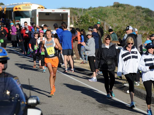 Clearing the way for Adam Roach during the 2015 Big Sur International Marathon on Sunday.