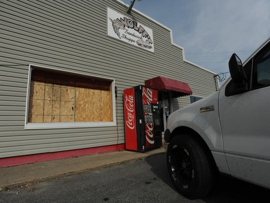 At Wolff's Sandwich Shoppe in Atlantic, the blast from the nearby Antares rocket explosion shattered a large glass pane Tuesday.
