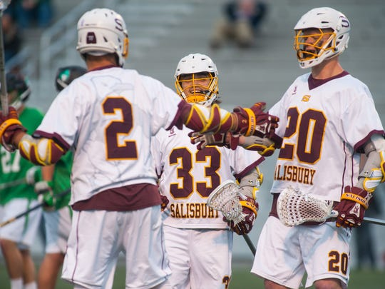 Salisbury's Thomas Cirillo (2), Carson Kalama (33) and Mike Kane (20) celebrate a goal against York College in the regular season Capital Athletic Conference finale on Wednesday at Sea Gull Stadium.