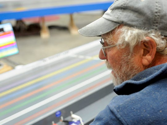 Lexington resident John Meister travels to Fishersville on Thursdays to race slot cars with his friends inside a garage owned by Lynn Combs.
