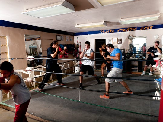 Boxers train at the Tulare Athletic Club in 2013. The Manuel Torrez Family Resource Center, which runs the gym, is sponsoring a Neighborhood Market Aug. 28 behind its new building, at 1331 S. O St. About 10,000 pounds of fresh fruits and vegetables will be given away courtesy of the Community Food Bank in Fresno.