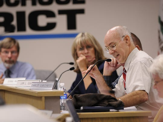 Board member Charles Ulmschneider, right, speaks during a Visalia Unified School District Board meeting on Tuesday, September 27, 2011. Superintendent Craig Wheaton, left, and Board member Donna Martin are also pictured. The Visalia Unified School District board of education will vote Tuesday evening on whether the district will choose to adopt a resolution which will move board of trustee elections from odd years to even years.