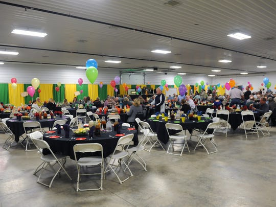 Guests enjoy food and drinks before the start of the first Muskingum County Reverse Raffle event. Proceeds from the raffle were donated to the Muskingum County 4-H program.