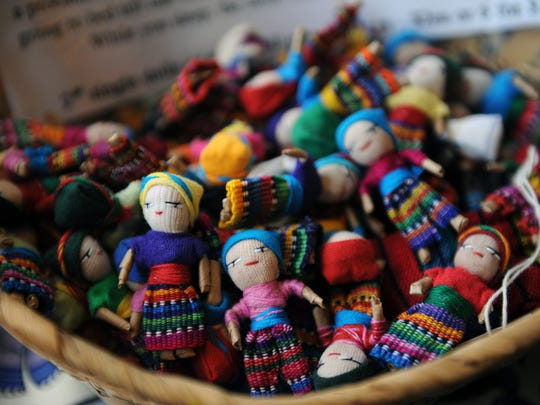 Fair Trade Guatemalan worry dolls rest in a basket for sale at Gemini's Eclectic Emporium at 522 Market St. in Zanesville. The new local business offers myriad items, including original artwork, psychedelic wall tapestries and various other novelty items.