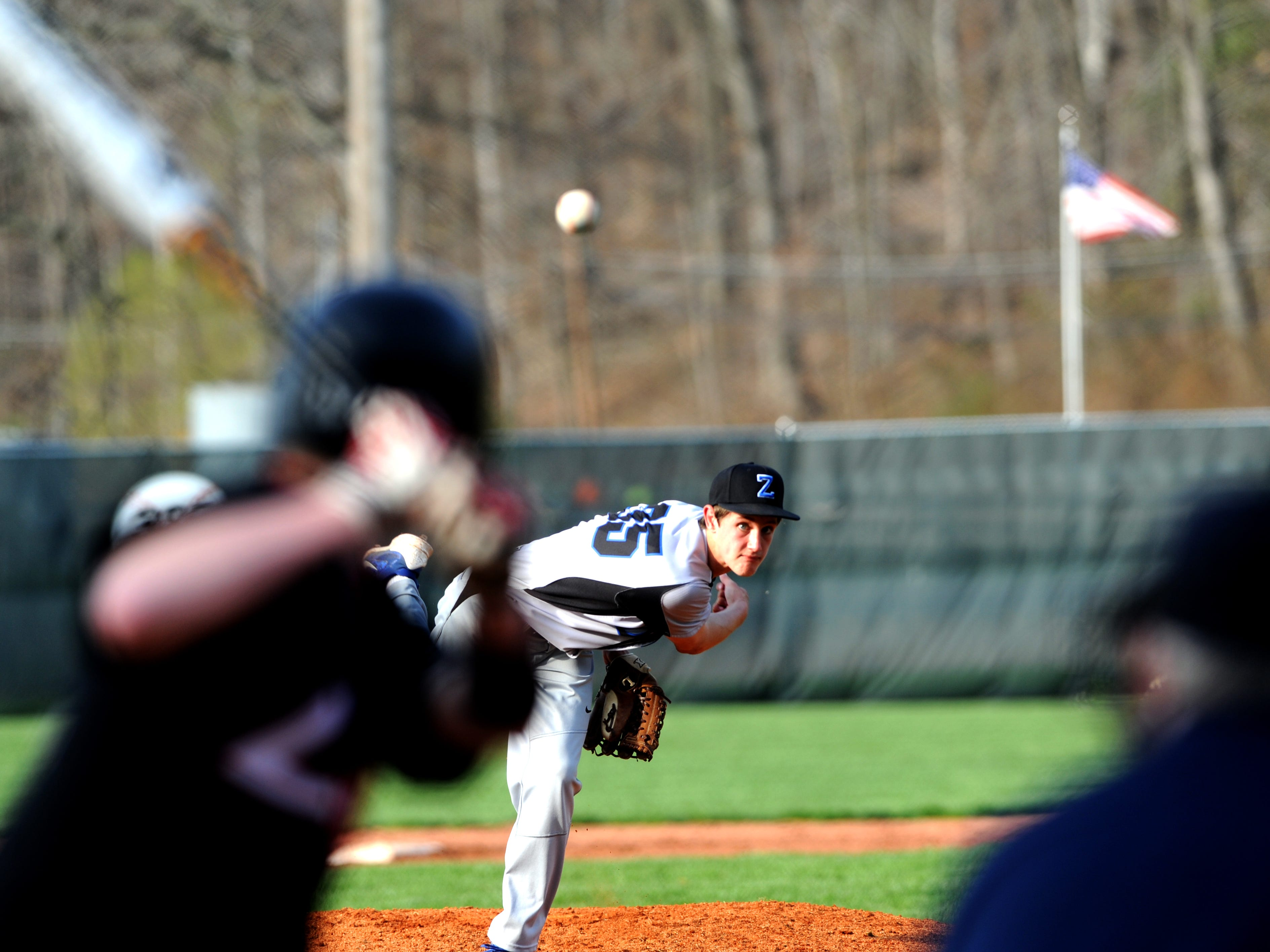 Zanesville's Caden Mumaw fires a pitch during the Blue Devils' 3-2 loss to Coshocton at Lake Park. Mumaw allowed one earned run Friday in 51/3 innings.