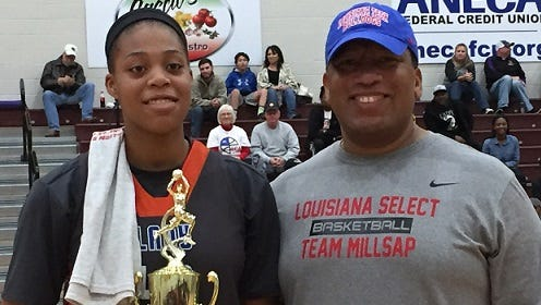 Mike Theus presents the MVP trophy to Southwood's Sheniqua Coatney Saturday at the Paul Millsap Classic.