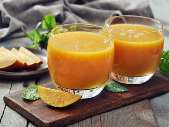 Add wine to your mango smoothie for a summertime treat.