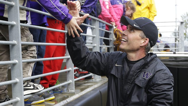 Washington coach Chris Petersen greets fans on April 19 following Washington's spring preview in Seattle. The team held an open practice and limited scrimmage, wrapping up their first spring session under their new head coach.