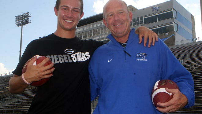 Brent Stockstill when he was at Siegel High School poses for a photo with MTSU coach Rick Stockstill.
