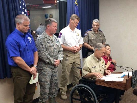 Gov. Greg Abbott briefs reporters in Austin on Sept.