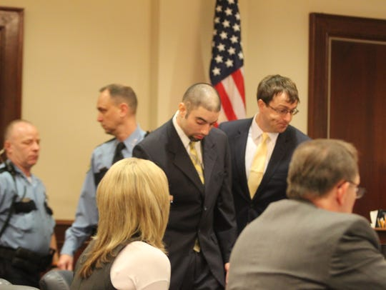 Radames Rivera and his attorney Chase Smith enter the