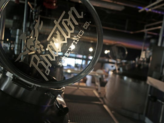 Glass portholes top the brewing vats at the Braxton Brewing Company Taproom.