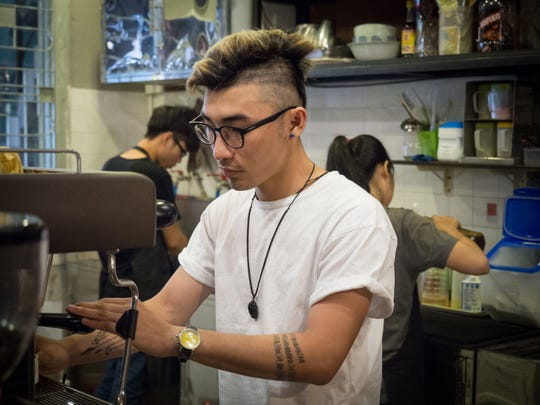 Nguyen Tuan Thanh prepares coffee at Caztus Coffee,