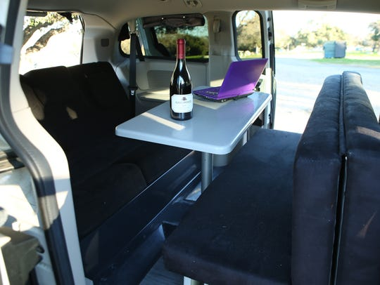 The cargo area transforms from a dining area to a bed