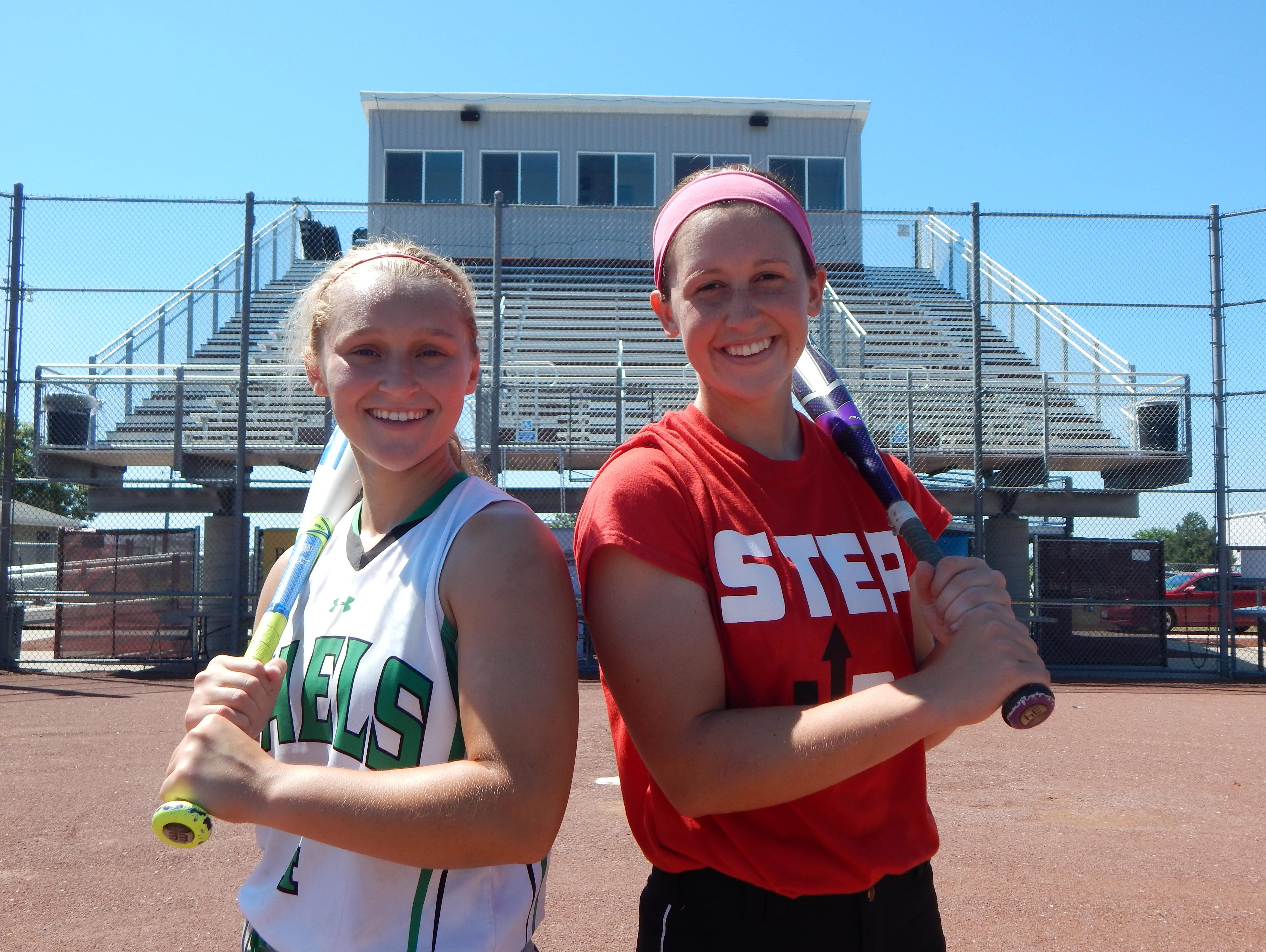 Fort Dodge St. Edmond's Jaci Stumpf (left) and Fort Dodge's Mallory Kilian stand in front of new bleachers at Rogers Sports Complex. Both teams reached the state tournament.