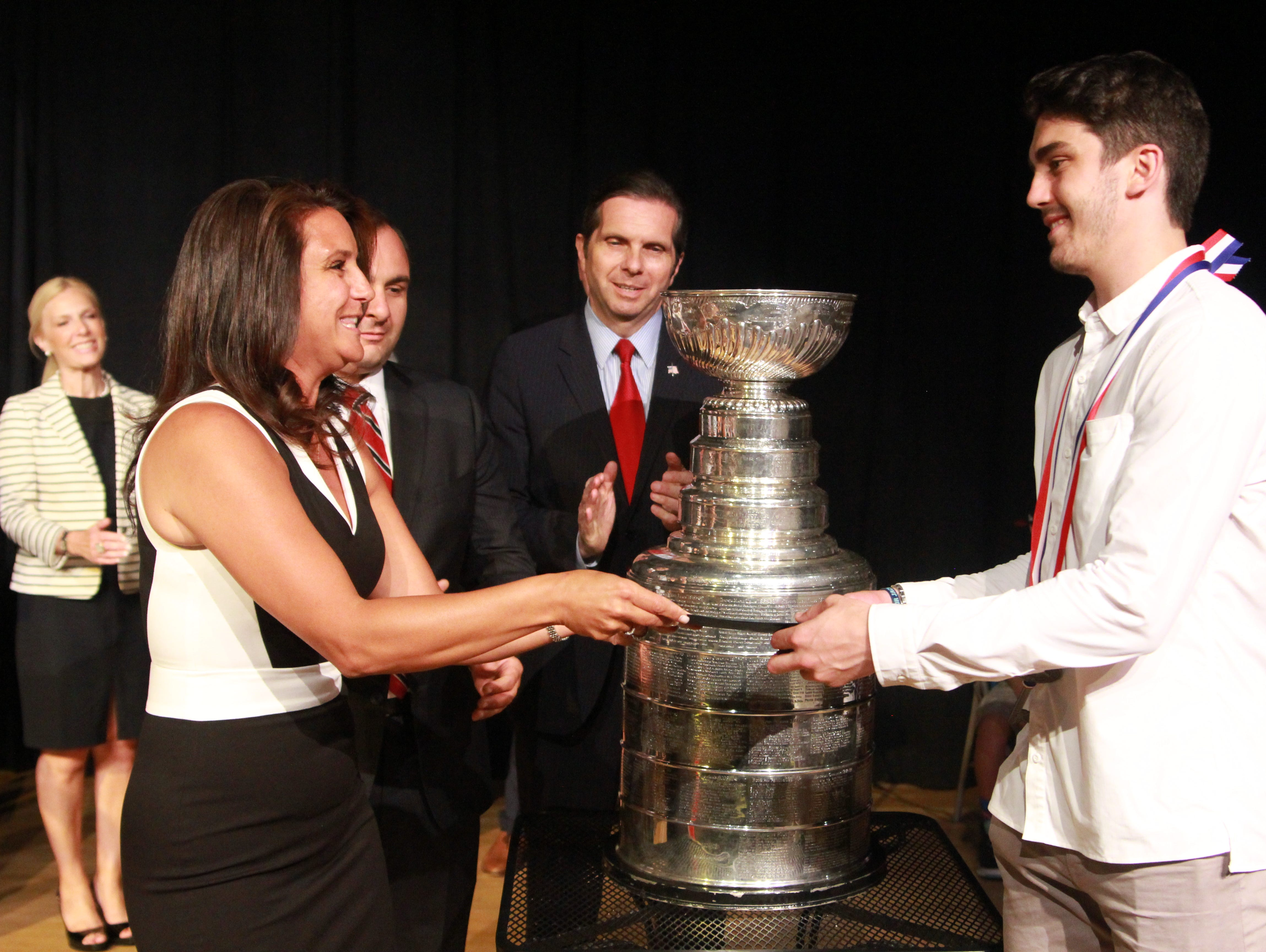 Middletown Mayor Stephanie C. Murray (left) provides Trevor van Riemsdyk with the key to the city at Middletown Arts Center.