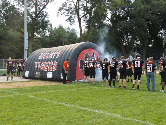 The Gillett football team uses an air tunnel to announce