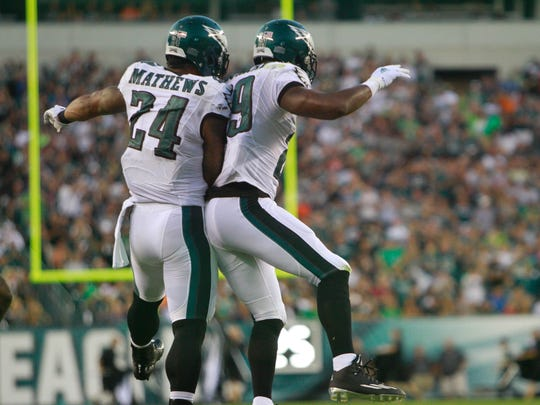 Eagles running back DeMarco Murray celebrates a first quarter touchdown with Ryan Mathews (No. 24). The Eagles host the Baltimore Ravens at Lincoln Financial Field Saturday.