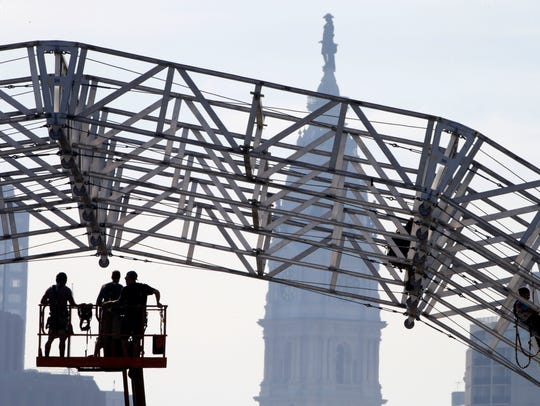 Workers build a stage ahead of Pope Francis' scheduled