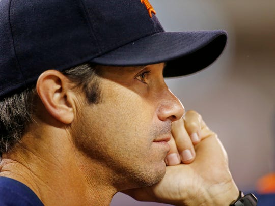Brad Ausmus watches the action during a September game in Minnesota.