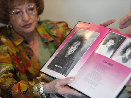 Shirley Fortner shows a memorial page in the 1990 Miller