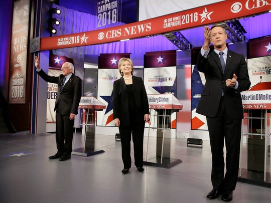 Democratic presidential candidates Bernie Sanders, left, Hillary Rodham Clinton and Martin O'Malley take the stage before a Democratic presidential primary debate, Saturday, Nov. 14, 2015, in Des Moines, Iowa. (AP Photo/Charlie Neibergall)