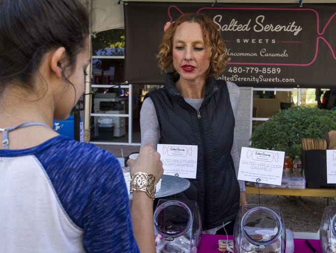Salted Serenity co-owner Elizabeth Picone gives a sample