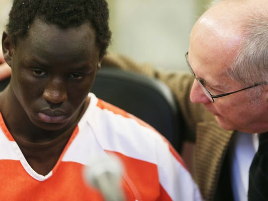 Ngor Makuey, 20, talks to his lawyer before being sentenced to life in prison on Monday, Jan. 4, 2016, at the Polk County courthouse for the murder of Rupert Anderson, 97, in Pleasant Hill in July of 2014. He was also convicted of assault with intent to commit serious injury, as well as robbery and burglary.