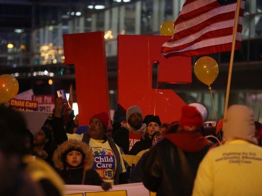 A group of fast-food workers, home care and child care workers, and community supporters march through the streets of Des Moines on Thursday, Jan. 28, 2016, to the steps of the Iowa Events Center where the final GOP debate before the Iowa Caucus was being held. The workers were fighting for a higher minimum wage and a union.