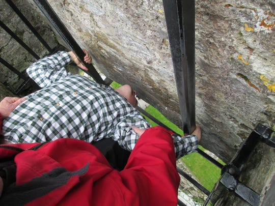 A Blarney Castle assistant holds Daddy Duty columnist