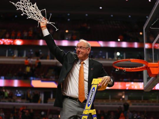 Syracuse Orange head coach Jim Boeheim waves to the