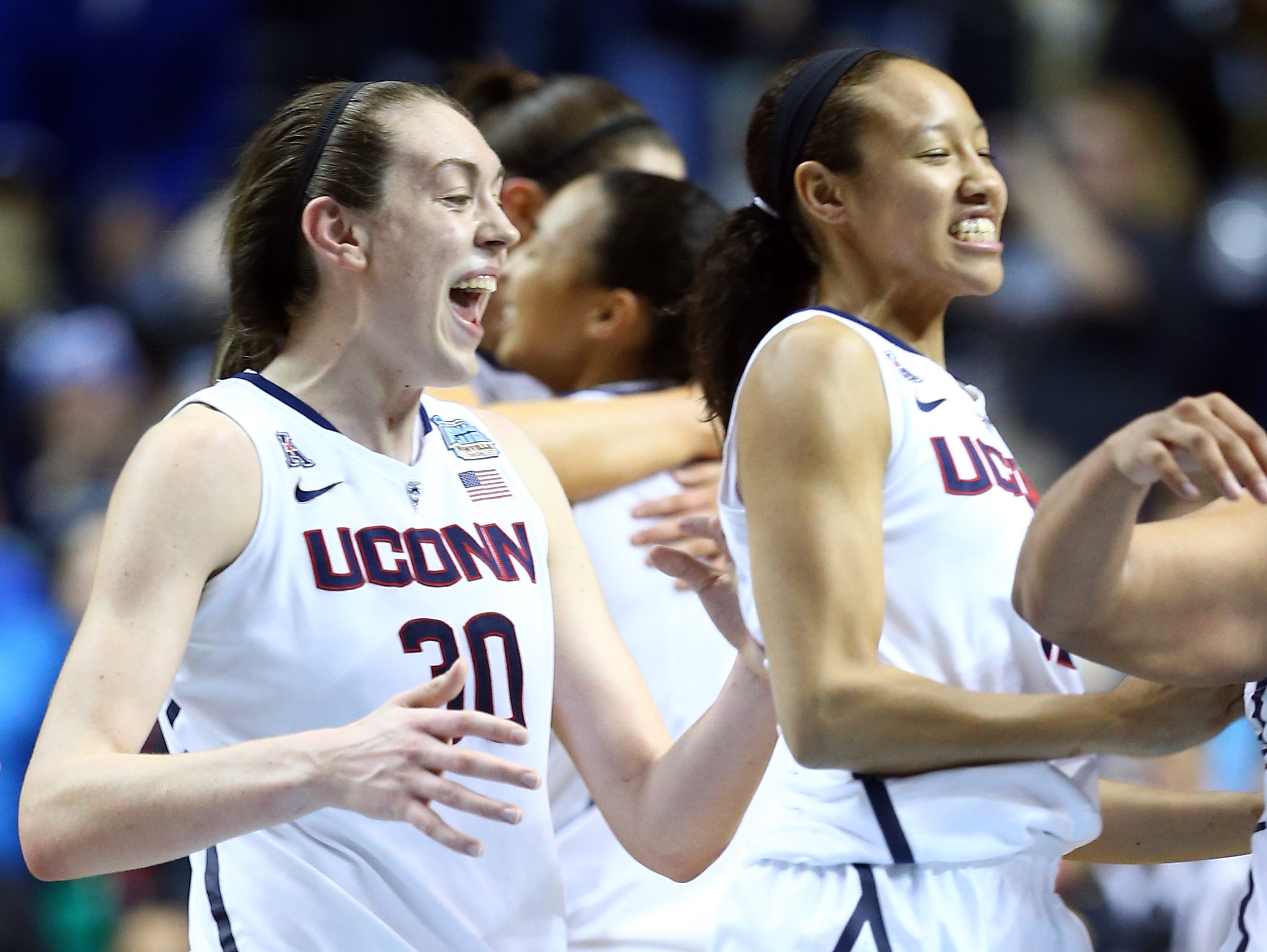 """Breanna Stewart of the Connecticut Huskies celebrates with her teammate Saniya Chong of Ossining after defeating the Notre Dame Fighting Irish in the 2014 NCAA Women's Final Four Championship at Bridgestone Arena in Nashville, Tennessee. Stewart and Chong have a """"special bond,"""" according to teammates."""