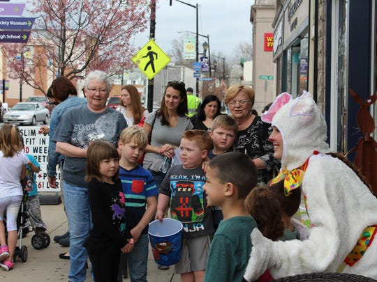 Children wait for their turn with the Easter Bunny.
