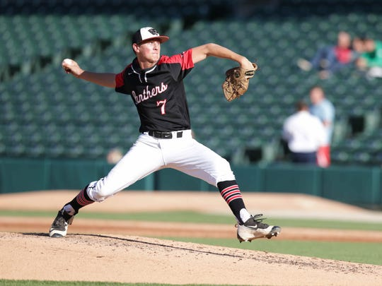 North Central's Alan Lozer pitches against Brebeuf during the the 2016 Marion County Tournament  at Victory Field, Friday May 13th, 2016.