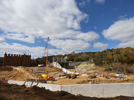 Construction work continues on the Lake Delhi Dam on October 9, 2015, in rural Delaware County. The dam was breached six years ago in July, 2010 during a flood draining the lake. Repairs to the dam are expected to be complete in the coming weeks and the lake will be refilled this summer.