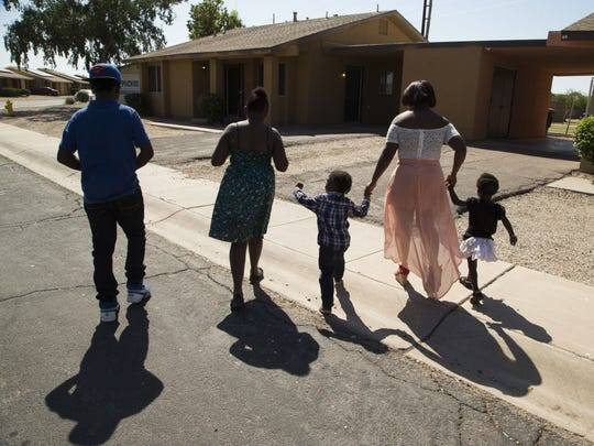 House of Refuge has helped families like Tenisha James and her children Shammarrion James (from left), Tanja James, Royalty Randall and Ashlee Randall, but that mission may be threatened by funding cutbacks.