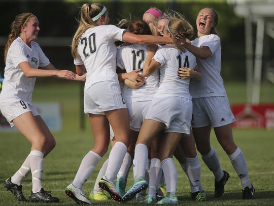 Ankeny Centennial celebrates its 2-1 win over Iowa City West's in the Class 3A championship game in 2016.