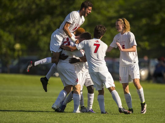 Iowa City City High's (9) Victor Brown-Rodriguez, top left, jumps on celebration of teammate Collin O'Meara's goal against Des Moines Roosevelt's in the first half during their 3A quarterfinal boys' state soccer match Thursday Jun 2, 2016, at Cownie Soccer Park in Des Moines, Iowa.