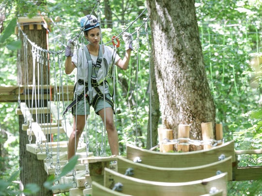 IndyStar reporter Alexa Goins tries out the nearly completed Koteewi Aerial Adventure Park & Tree Top Trails at Strawtown Koteewi Park in Noblesville.